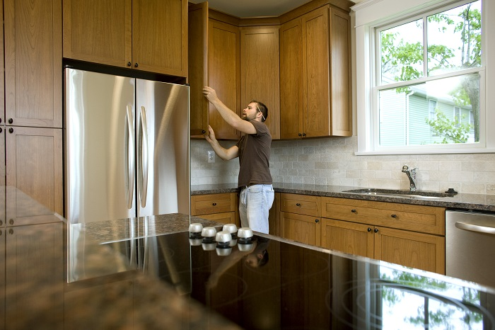 Man Inspecting Kitchen